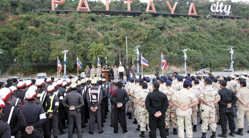 police officers crowd at the pattaya sign